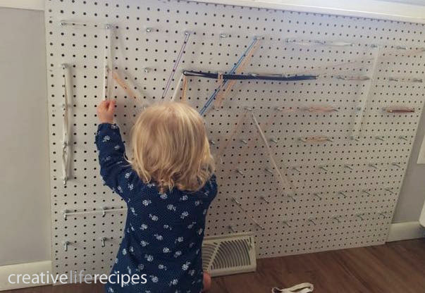 Make Your Own Rubber Band Wall Child Playing by Creative Life Recipes